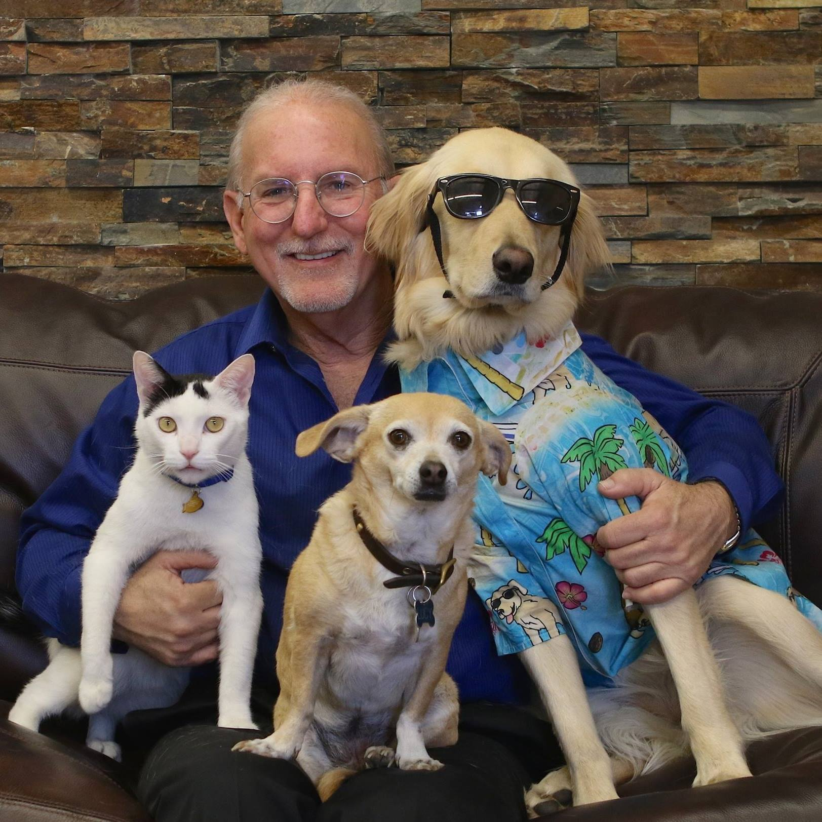 Lucy Pet Founder Joey Herrick with Ricky the Rescue Cat, Lucy, and Surfin' Jack